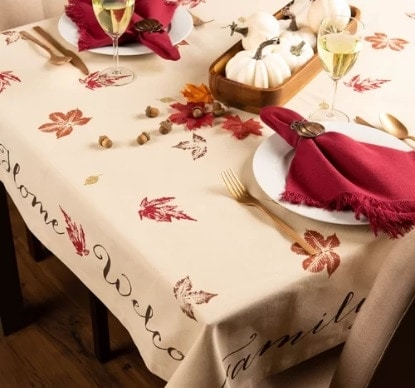 Thanksgiving tablecloth with printed maple leaves, harvest wheat, and holly berries in warm autumn colors